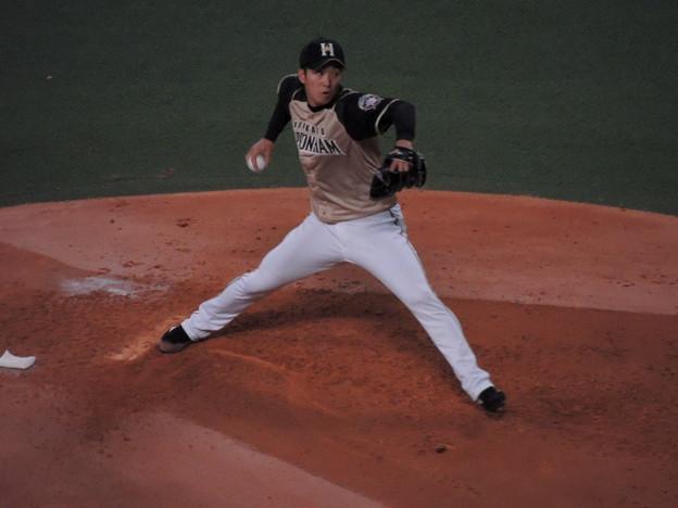 写真: 斉藤祐樹投手。