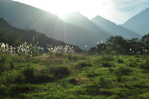 白馬より秋暮の陽