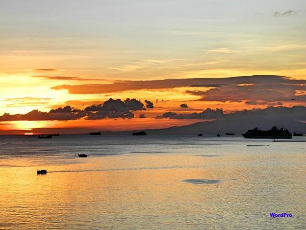 マニラ湾、夕陽、出港