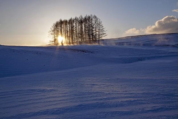 朝日と雪煙