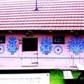 青い花の絵の家